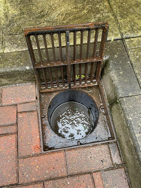 Capital Drainage drain blocked by mud and debris after